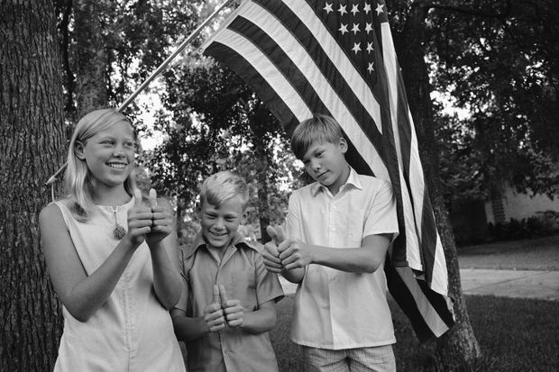 Janice Aldrin, 11, and her brothers, Andrew, 10, and James Michael 13, give a thumbs up  after the 1969 launch of Apollo 11 spaceflight carrying their father.