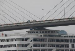 Whoops!  Chinese cruise liner collides into bridge!