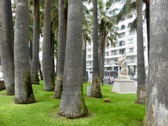A small treed park lies in the center of the city